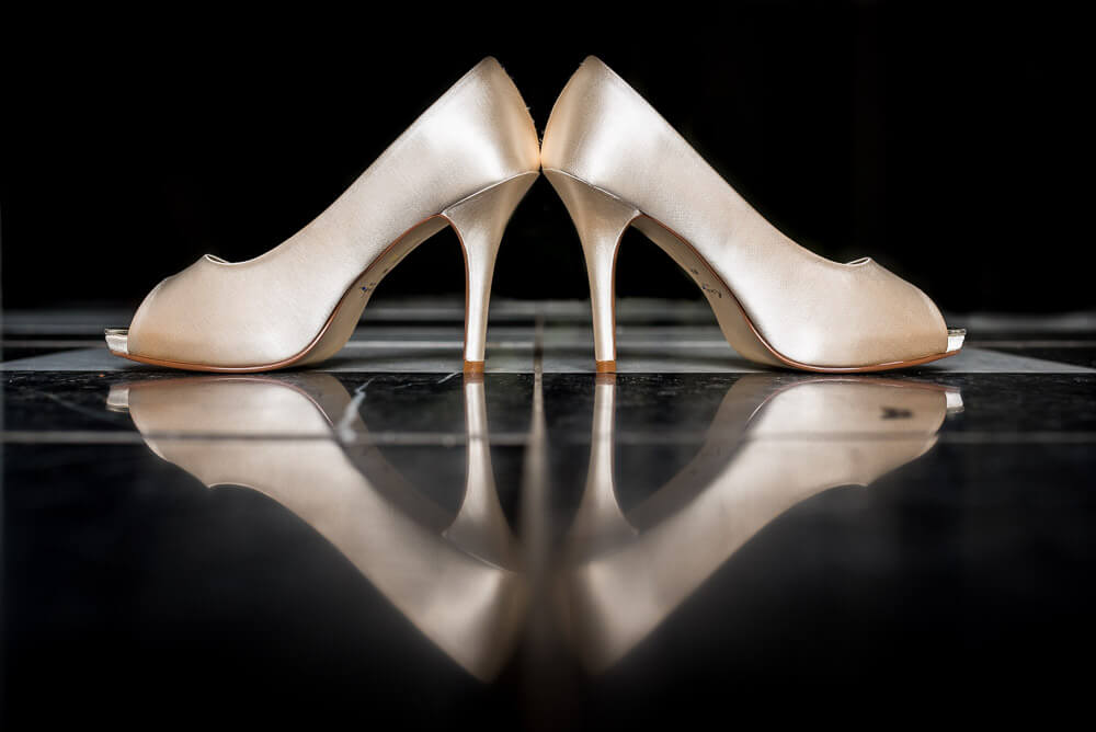 Brides shoes with reflection in the tiles