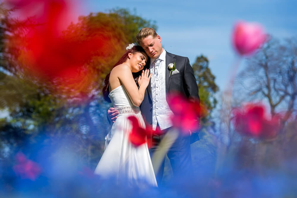 Bride and groom through flowers