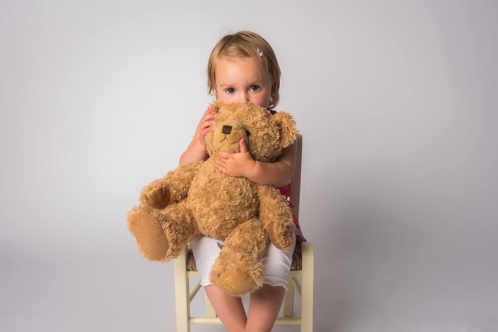 cute little girl holding teddy bear