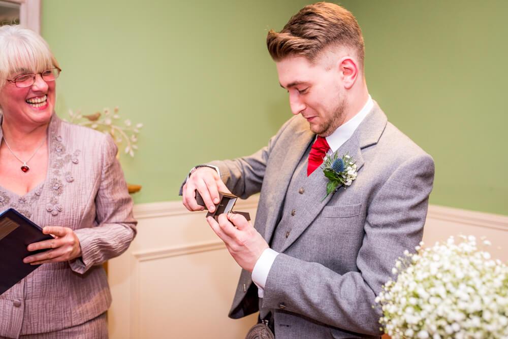 Best man handing over the rings