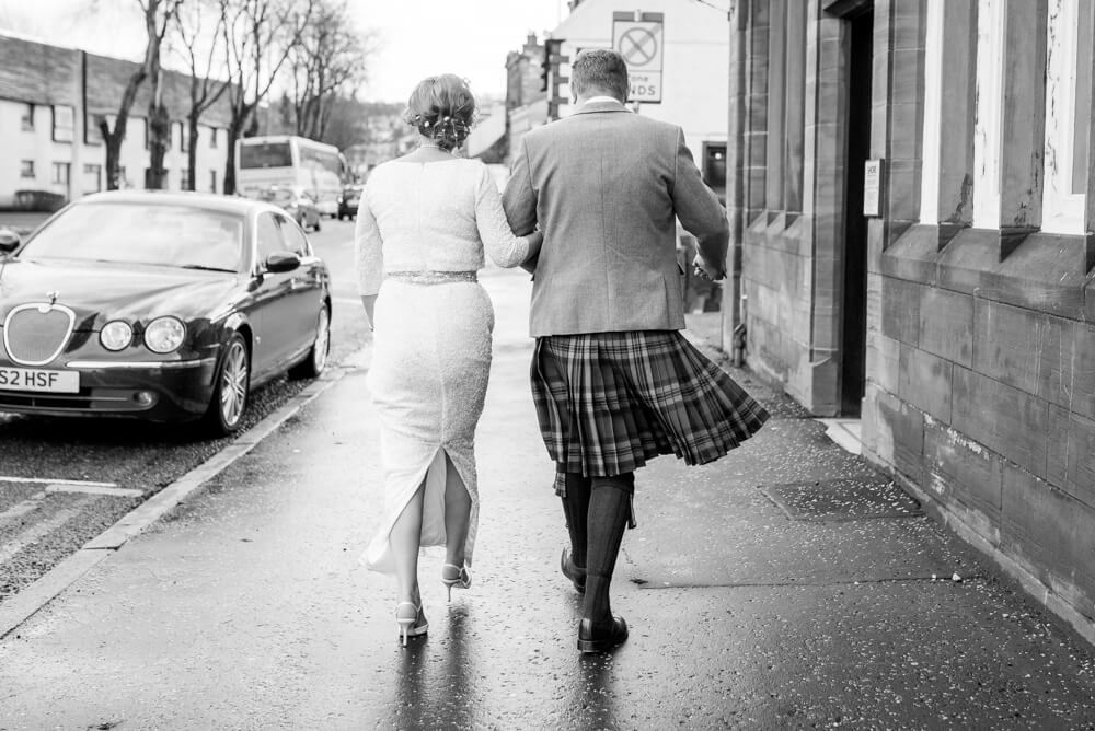 Back of bride and groom walking