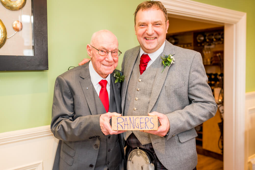 Father of the bride giving groom a Rangers brick