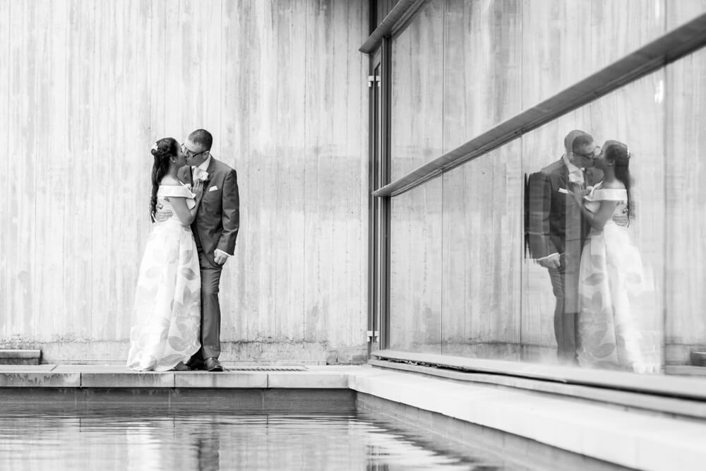 Bride and Groom kiss with reflection