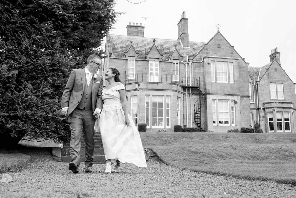 Bride and Groom with Norton House in background