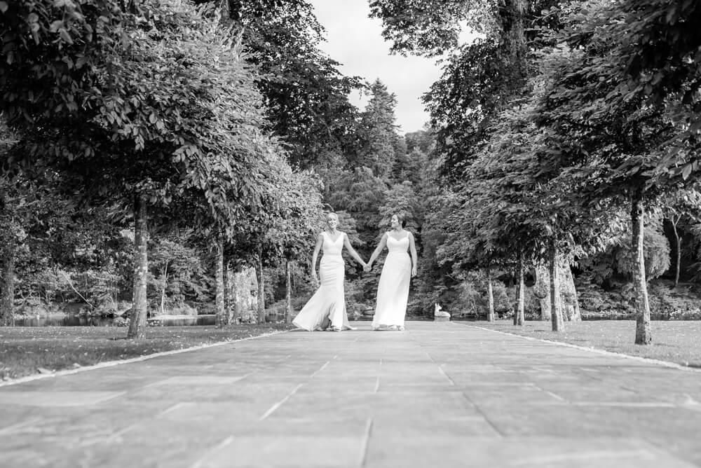 Brides holding hands whilst walking