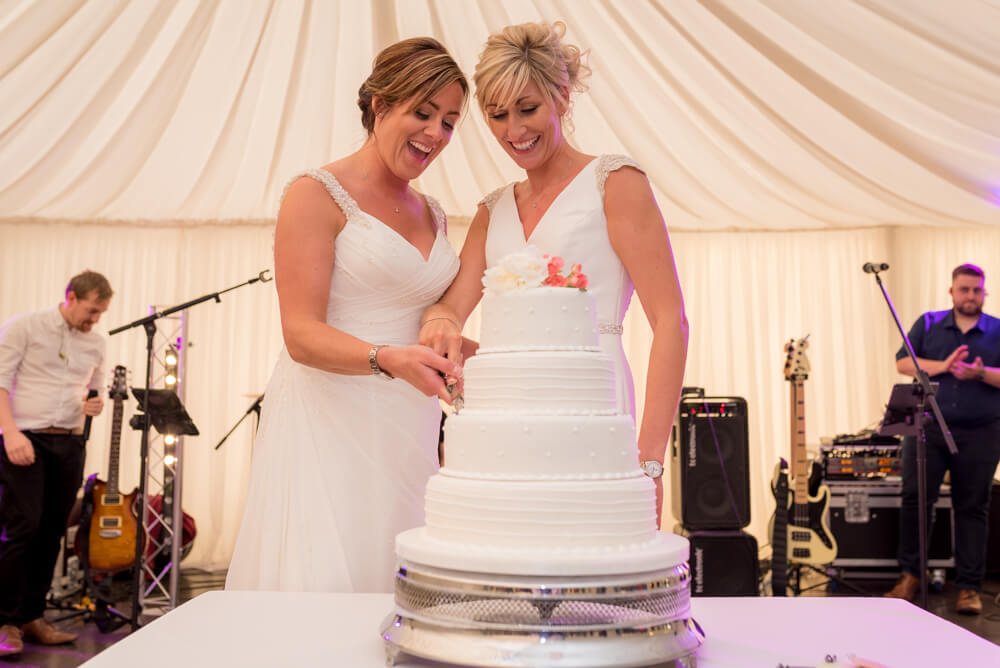 Brides cutting wedding cake