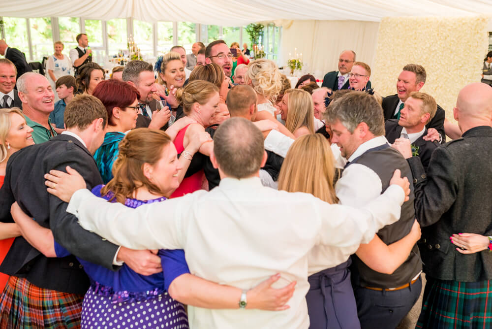 Wedding guests dancing in a circle