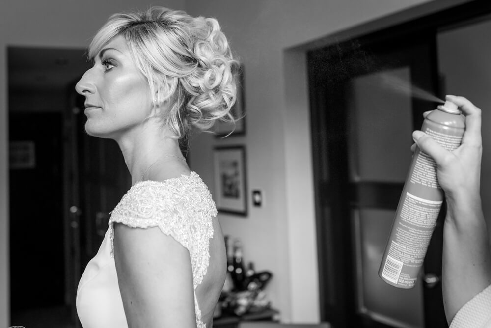 Bride getting hairspray done