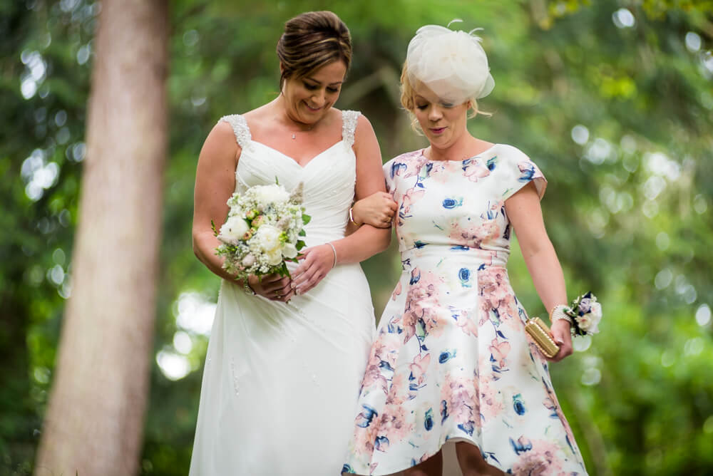 Bride and bridesmaid walking down aisle