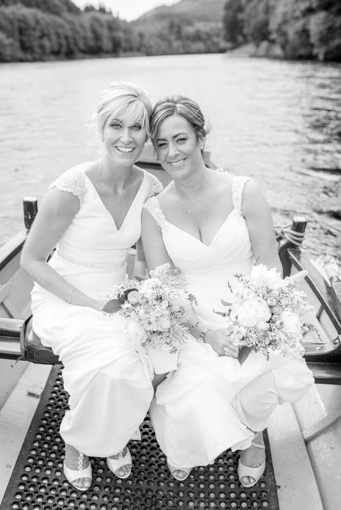 Brides smiling on boat