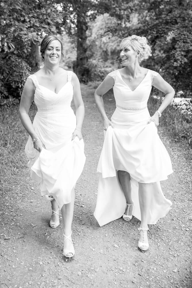 Brides walking holding wedding dress