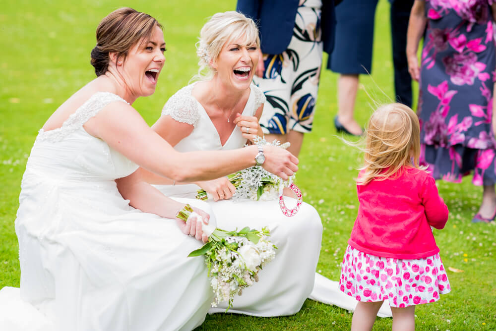 Brides and cute girl laughing