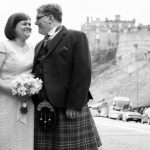 Bride and groom outside Edinburgh Castle