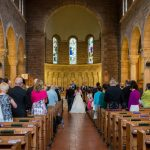 Bride walking down the aisle at St Anne's Parish Church