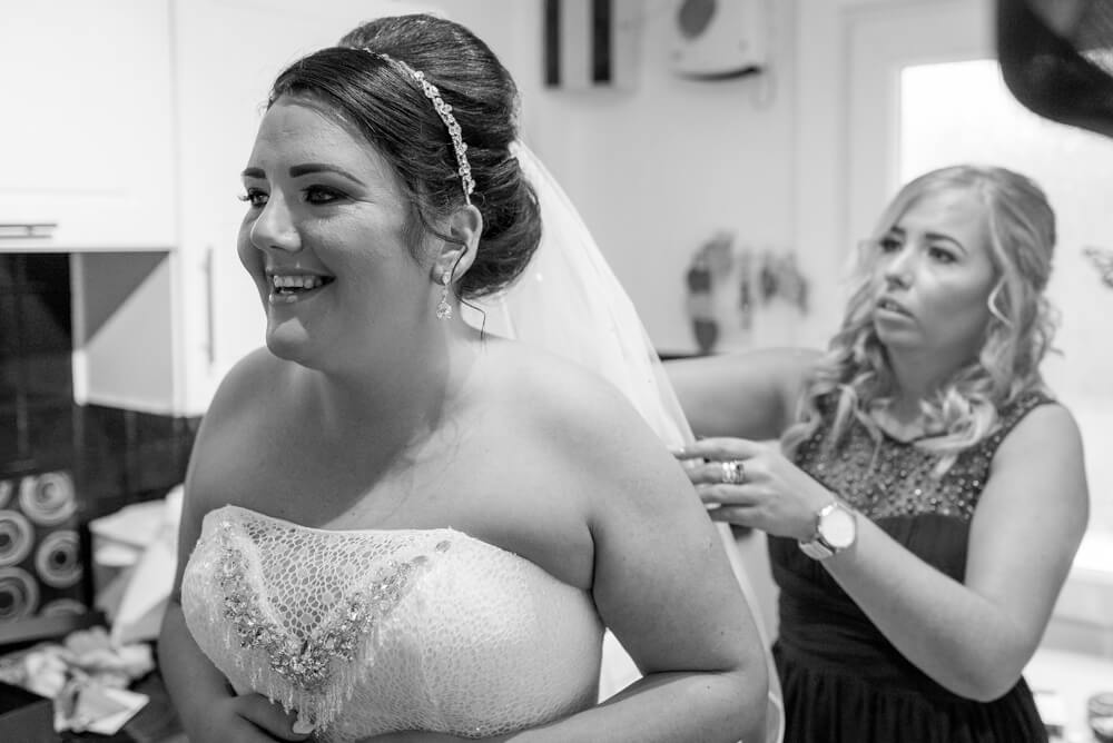 Bridesmaid doing brides veil