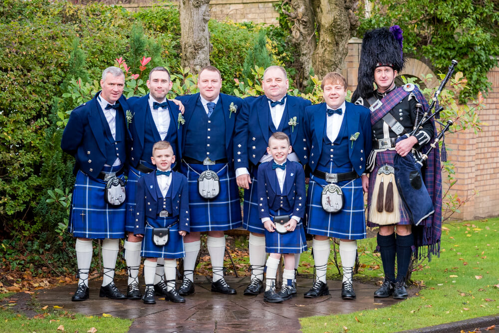 Groom with his ushers and piper