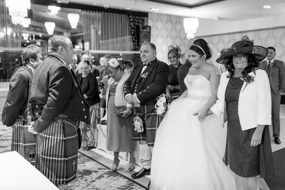 Bride walking down the aisle with mother at The Parkville Hotel