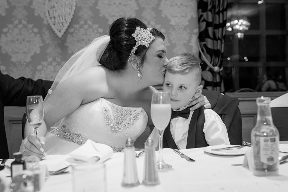 Bride kissing her son