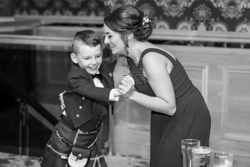 Bridesmaid dancing with page boy