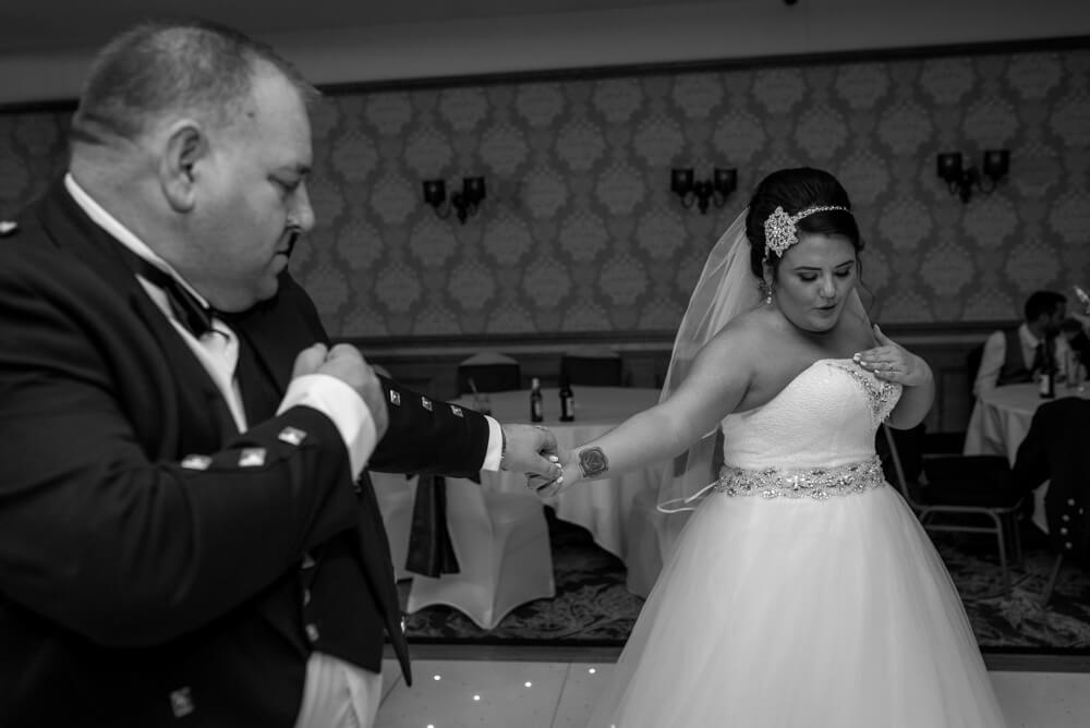 Bride and father of the bride dancing