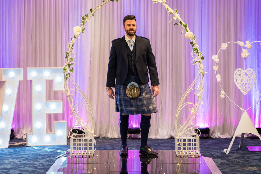 Groom in kilt walking down catwalk
