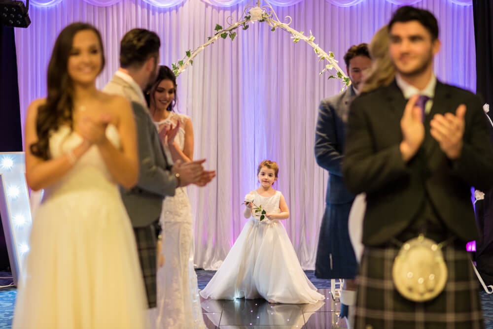 Cute flower girl, brides and grooms during Edinburgh Wedding Exhibition