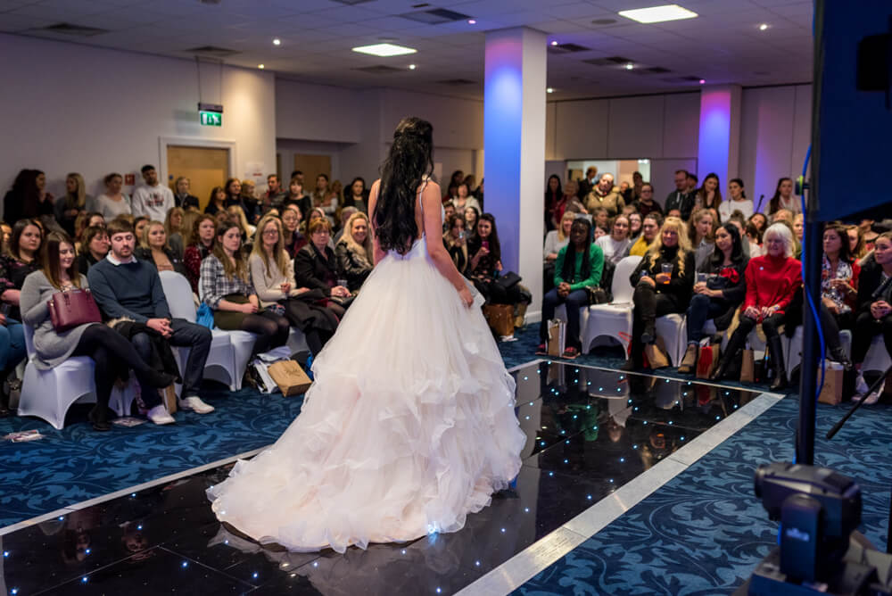 Bride walks down catwalk at Wedding fair